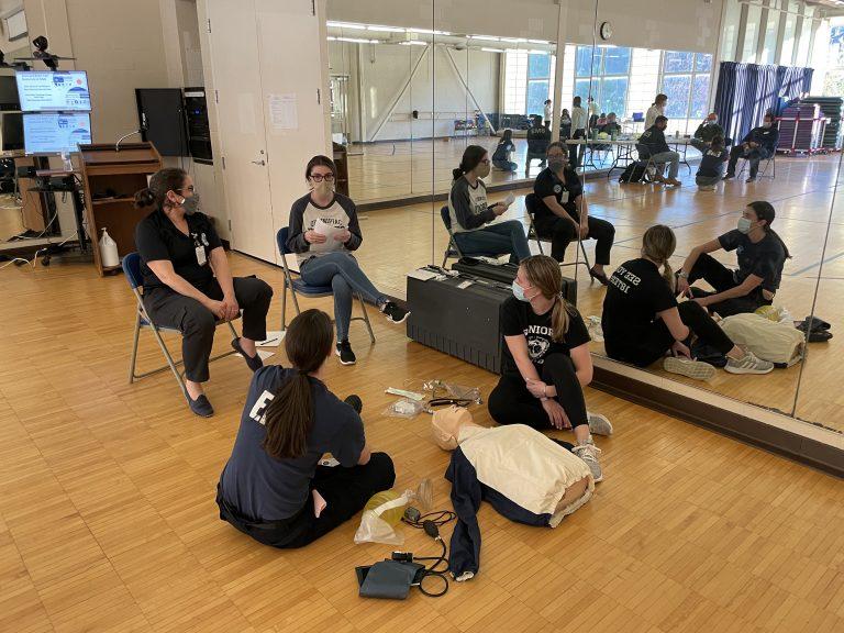 QU EMS members practicing their EMS skills