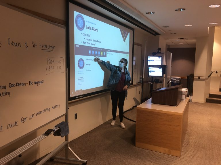 QU EMS member Madison Murphy hosting a documentation training